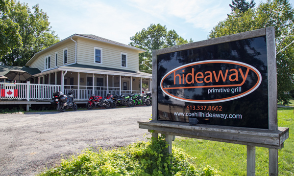 Sign for Hideaway with lots of bikes in the background