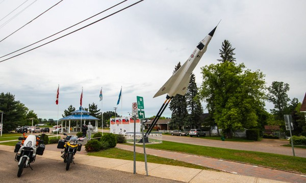 Two motorcycles beside Avro Arrow monument