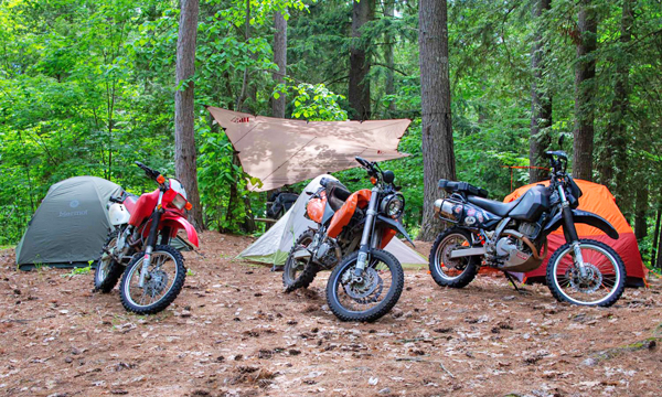 Motorcycles parked with tents