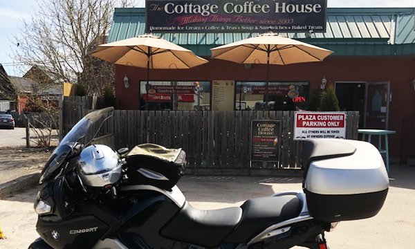 Motorcycle in front of Cottage Coffee building