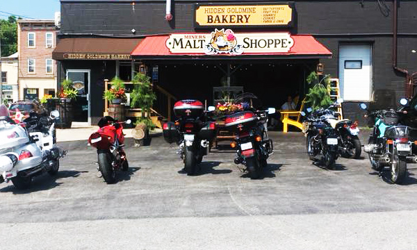 Motorcycles in front of ice cream shop