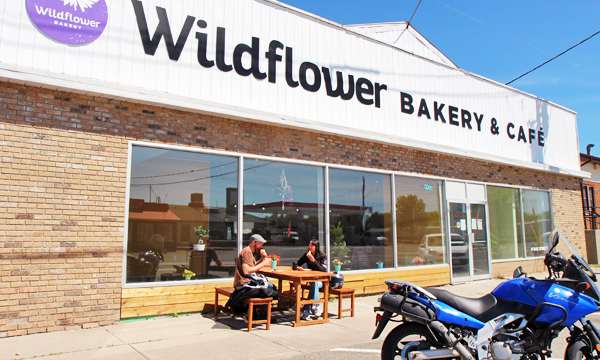 Wildflower bakery storefront with Motorcycle