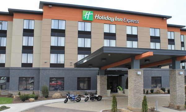 Holiday Inn Express brown building with 2 motorcycles sitting in front